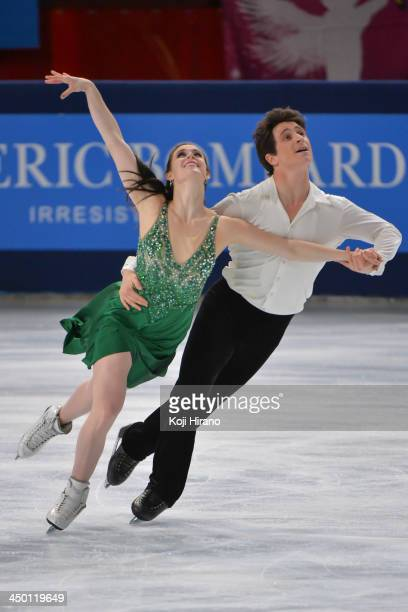 Tessa Virtue and Scott Moir perform in the ice dance's free program during day two of Trophee Eric Bompard ISU Grand Prix of Figure Skating 2013/2014...