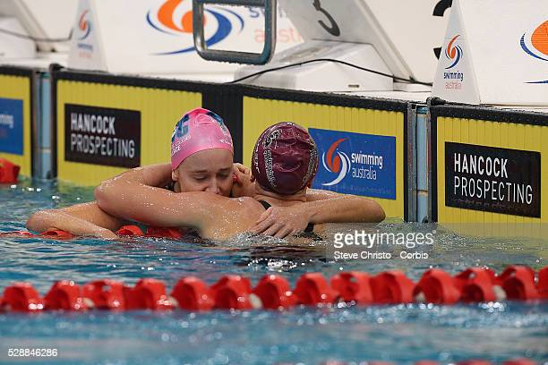 Tessa Wallace hugs Keryn McMaster after combating in the Women's 400m Individual Medley during the Hancock Prospecting Australian Swimming...