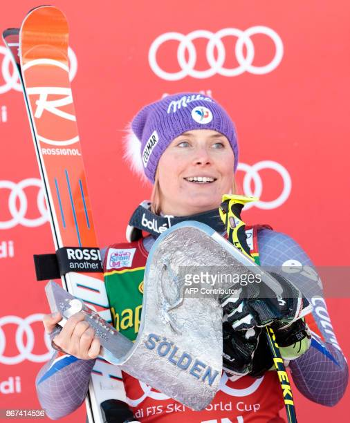 Tessa Worley of France celebrates on the podium after the women's Giant Slalom event of the FIS ski World cup in Soelden Austria on October 28 2017...