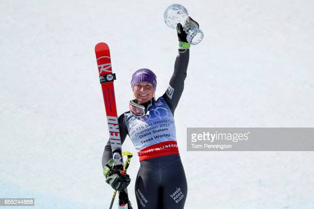 Tessa Worley of France celebrates with her globe for winning the season title for the ladies' Giant Slalom during the 2017 Audi FIS Ski World Cup...