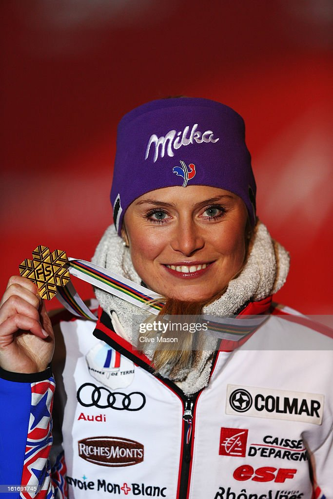 Tessa Worley of France celebrates with her gold at the medal ceremony after winning the Women's Giant Slalom during the Alpine FIS Ski World Championships on February 14, 2013 in Schladming, Austria.