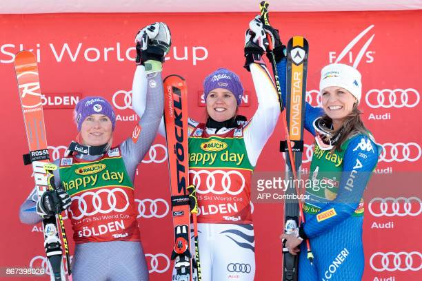 Tessa Worley of France Viktoria Rebensburg of Germany and Manuela Moelgg of Italy celebrate on the podium after the women's Giant Slalom event of the...