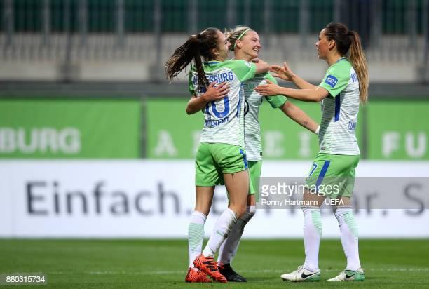 Tessa Wullaert Alexandra Popp and Sara Bjork Gunnarsdottir of Wolfsburg celebrate after scoring during the UEFA Women Champions League Round of 32...