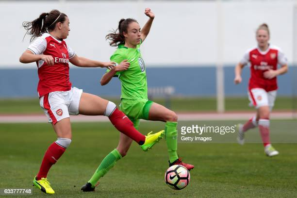 Tessa Wullaert of Wolfsburg challenges Carla Humphrey of Arsenal during the Women's Friendly Match between VfL Wolfsburg Women's and Arsenal FC Women...