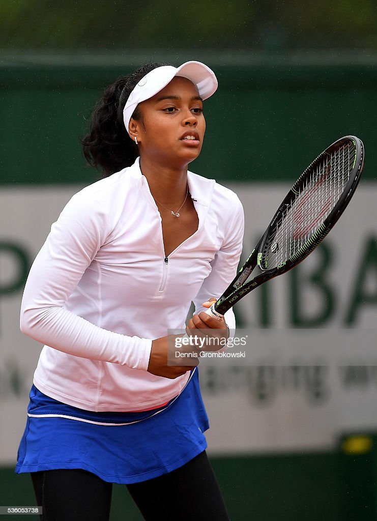 Tessah Andrianjafitrimo awaits a serve during the Girls Singles first round match against Ayano Shimizu of Japan on day ten of the 2016 French Open at Roland Garros on May 31, 2016 in Paris, France.