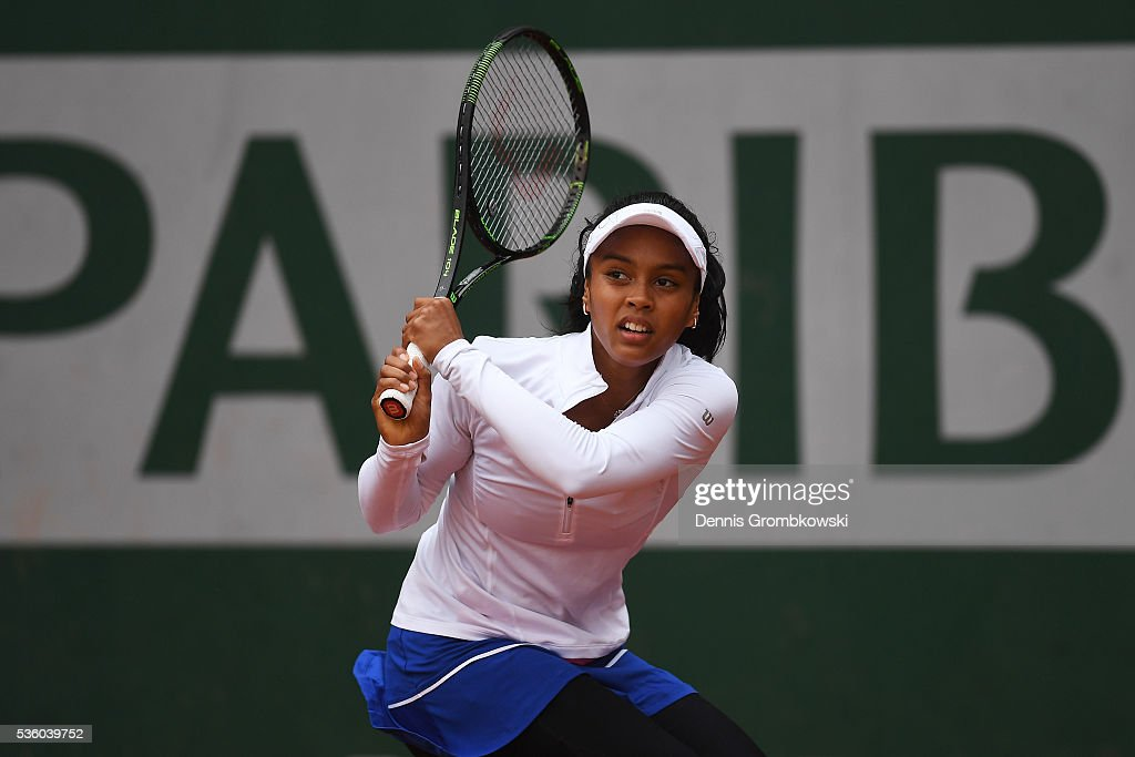 Tessah Andrianjafitrimo hits a backhand during the Girls Singles first round match against Ayano Shimizu of Japan on day ten of the 2016 French Open at Roland Garros on May 31, 2016 in Paris, France.