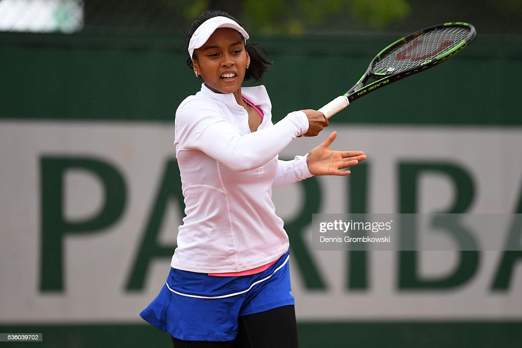 Tessah Andrianjafitrimo hits a forehand during the Girls Singles first round match against Ayano Shimizu of Japan on day ten of the 2016 French Open at Roland Garros on May 31, 2016 in Paris, France.