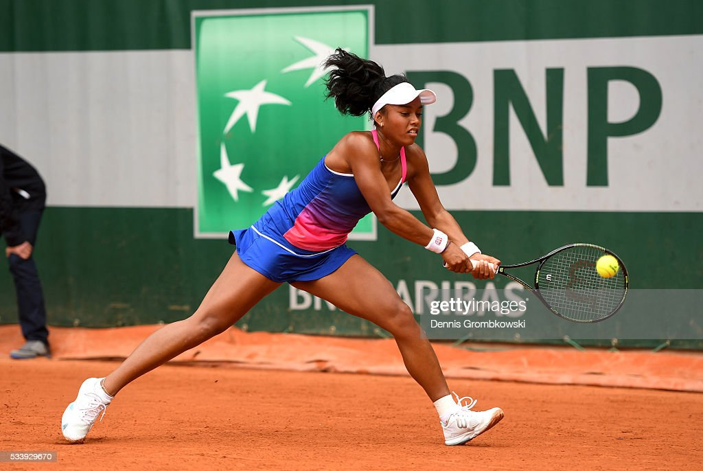 Tessah Andrianjafitrimo of France plays a backhand during the Women's Singles first round match against Qiang Wang of China on day three of the 2016 French Open at Roland Garros on May 24, 2016 in Paris, France.