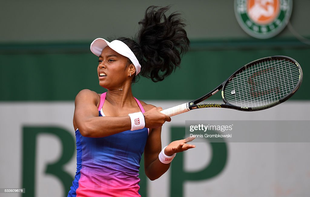 Tessah Andrianjafitrimo of France plays a forehand during the Women's Singles first round match against Qiang Wang of China on day three of the 2016 French Open at Roland Garros on May 24, 2016 in Paris, France.