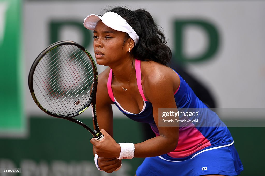 Tessah Andrianjafitrimo of France prepares to return a serve during the Women's Singles first round match against Qiang Wang of China on day three of the 2016 French Open at Roland Garros on May 24, 2016 in Paris, France.