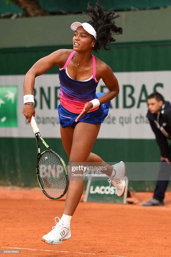 Tessah Andrianjafitrimo of France serves during the Women's Singles first round match against Qiang Wang of China on day three of the 2016 French Open at Roland Garros on May 24, 2016 in Paris, France.