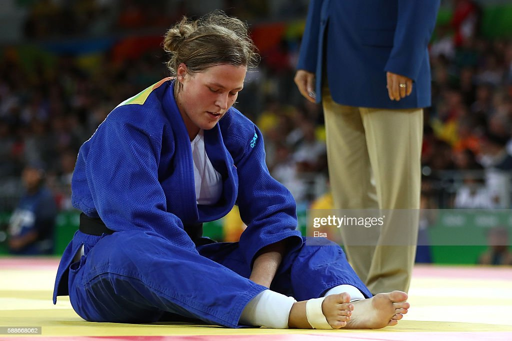 Tessie Savelkouls of the Netherlands reacts after competing against Kanae Yamabe of Japan during the Women's 78kg Judo contest on Day 7 of the Rio...