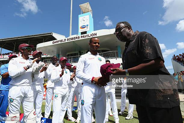 Test debut Shai Hope of West Indies is presented with his cap by Clive Lloyd of West Indies during day one of the 3rd Test match between West Indies...