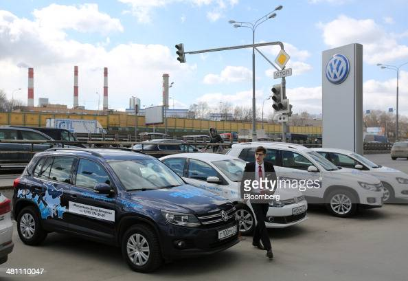 Test drive vehicles stand in a parking lot outside a Volkswagen AG automobile dealership in Moscow Russia on Friday March 28 2014 Foreign companies...