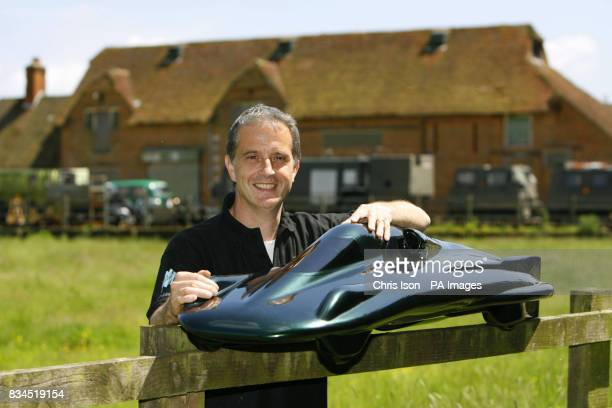 Test driver Don Wales with a scale model of the British Steam Car currently under construction in the New Forest Hampshire