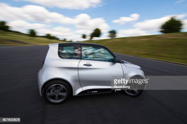 A test driver drives an eGo Life electric compact automobile manufactured by eGo Mobile AG installed with electric drive systems developed by Robert...