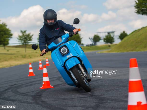 A test driver rides between road cones on an eSwallow electric motor scooter manufactured by Horex GmbH with electric drive systems developed by...