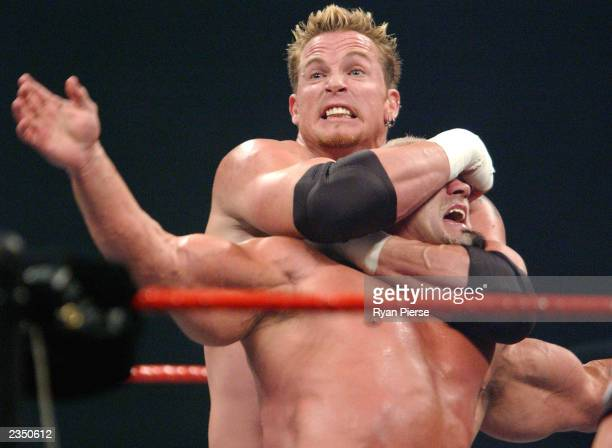 Test has Big Pappa Pump in a headlock during the WWE Raw Aggression Tour event at Rod Laver Arena Melbourne Park July 31 2003 in Melbourne Australia