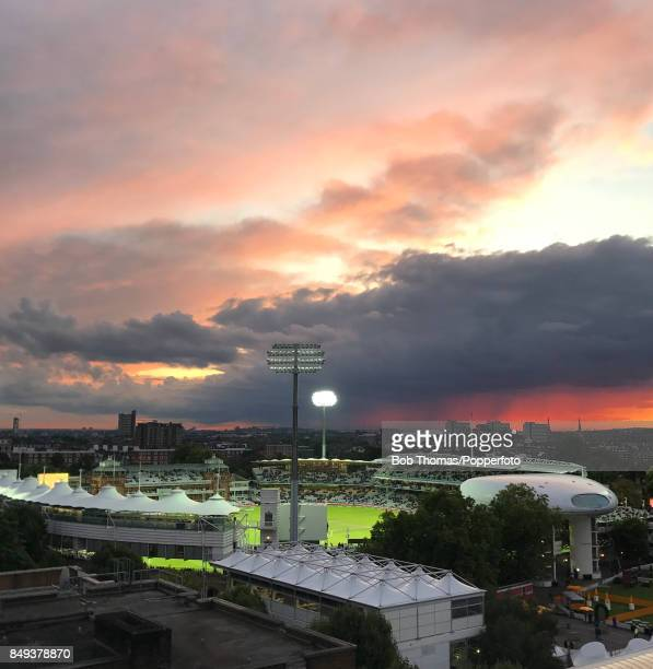 Test match cricket continues beneath a dramatic sky at Lord's cricket ground in London which is floodlit as the sun sets in the west with this image...
