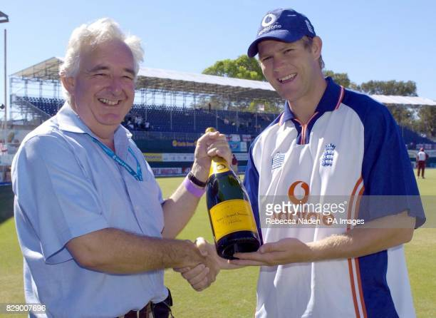 BBC Test Match Special producer Peter Baxter presents a magnum of champagne to England bowler Matthew Hoggard at the Recreation ground St John's...