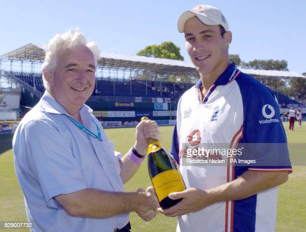 BBC Test Match Special producer Peter Baxter presents a magnum of champagne to England bowler Simon Jones at the Recreation ground St John's Antigua...