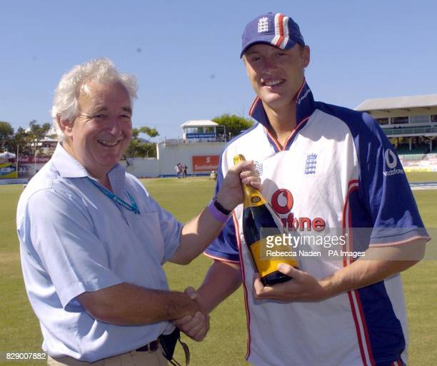 BBC Test Match Special producer Peter Baxter presents a magnum of champagne to England cricketer Andrew Flintoff at the Recreation ground St John's...