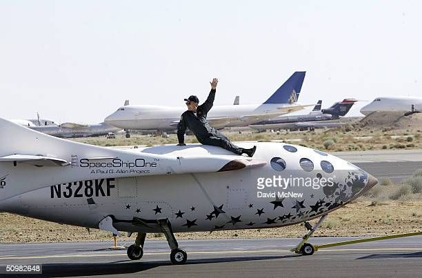Test pilot Michael Melvill rides atop of SpaceShipOne as it is towed down the runway following his flight to a height of 62 miles in the first...