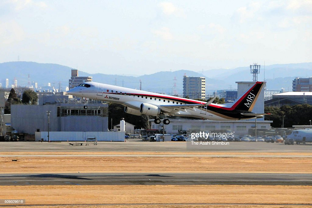 A test plane of the Mitsubishi Regional Jet (MRJ) takes off at the Nagoya Airport on February 10, 2016 in Toyoyama, Aichi, Japan. Mitsubishi Aircraft Corp has already announced the delivery of the first domestically produced passenger jet will be delayed to late 2018.