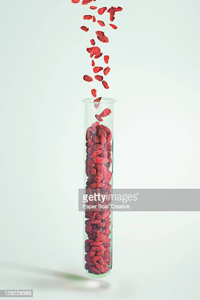Test Tube with Goji Berries falling in