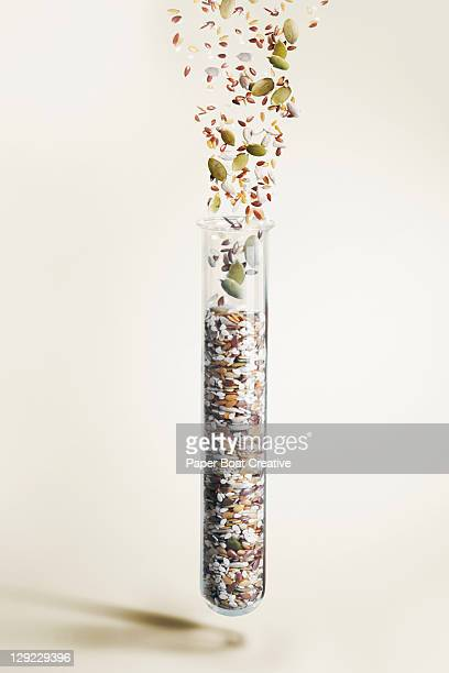 Test Tube with mixed health seeds falling in
