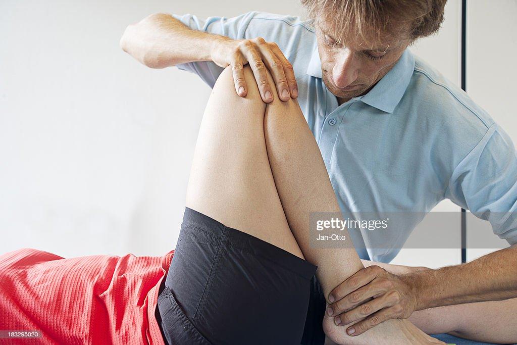 Testing flexibility of a knee : Stock Photo