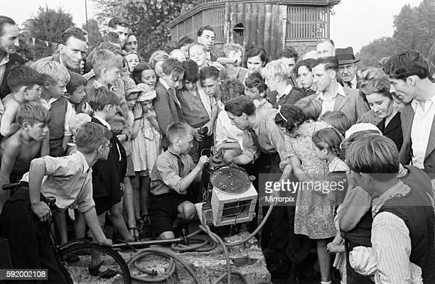 Testing out home made diving equipment with crowds watching Wiltshire Circa 1945