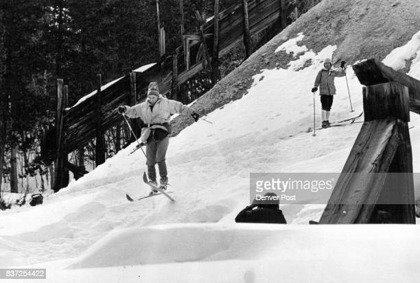 Testing Skills A crosscountry skier turned ski jumper is photographed by a companion while another waits his turn at the Bard Greek Mine above Empire...