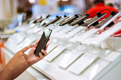 Buying smartphone in an electronics store
