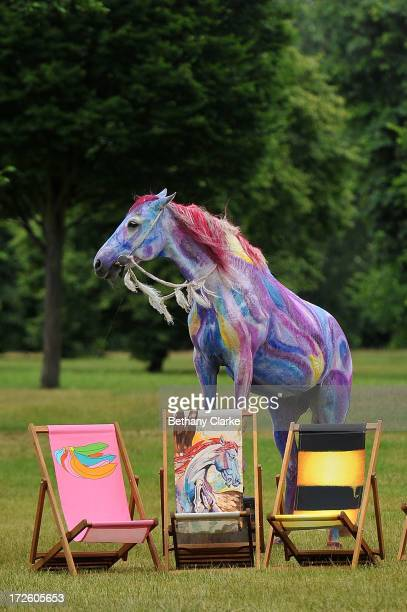 Teta a horse painted to match the painting 'Pegasus' by Ronnie Wood poses with a deckchair designed by the musician in Hyde Park on July 4 2013 in...