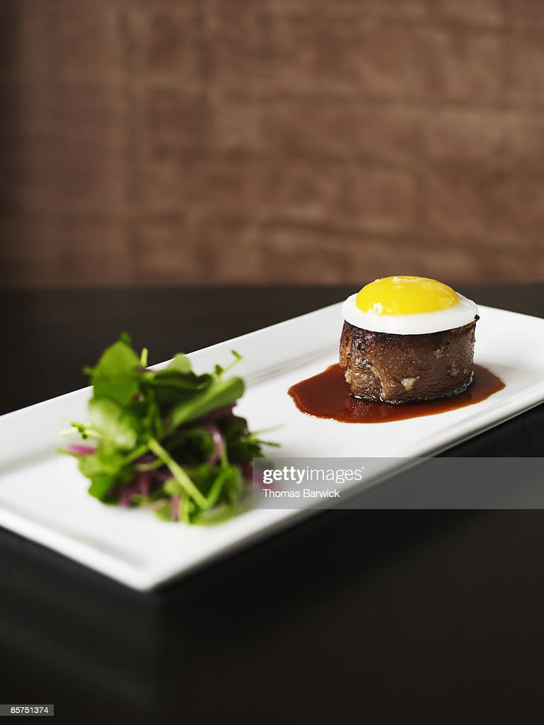 Tete de cochon with duck egg and salad : Stock Photo
