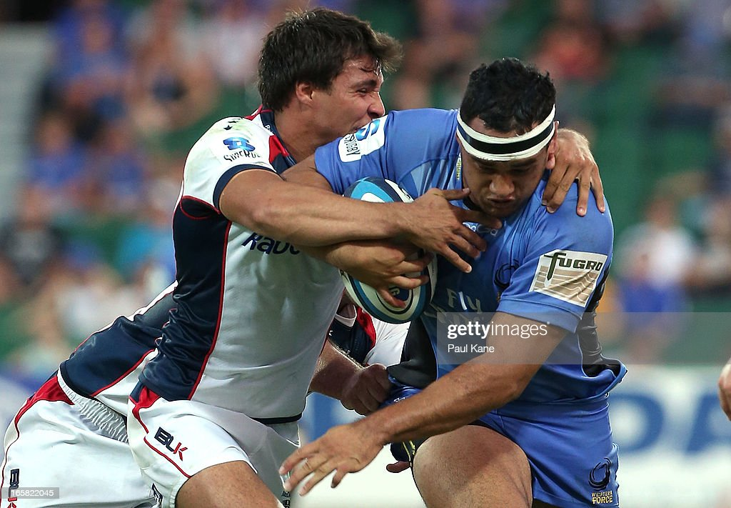 Tetera Faulkner of the Force attempts to break from a tackle by Nick Phipps of the Rebels during the round eight Super Rugby match between the Western Force and the Melbourne Rebels at nib Stadium on April 6, 2013 in Perth, Australia.