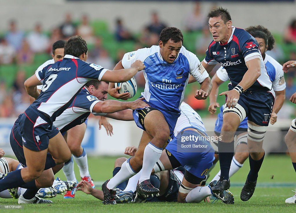 Tetera Faulkner of the Force is tackled during the round one Super Rugby match between the Rebels and the Force at AAMI Park on February 15, 2013 in Melbourne, Australia.