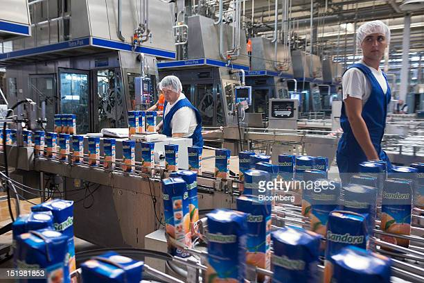 Tetra Pak cartons of Sandorabrand grapefruit juice move along the production line at PepsiCo Inc's Sandora beverage plant in Nikolaev Ukraine on...