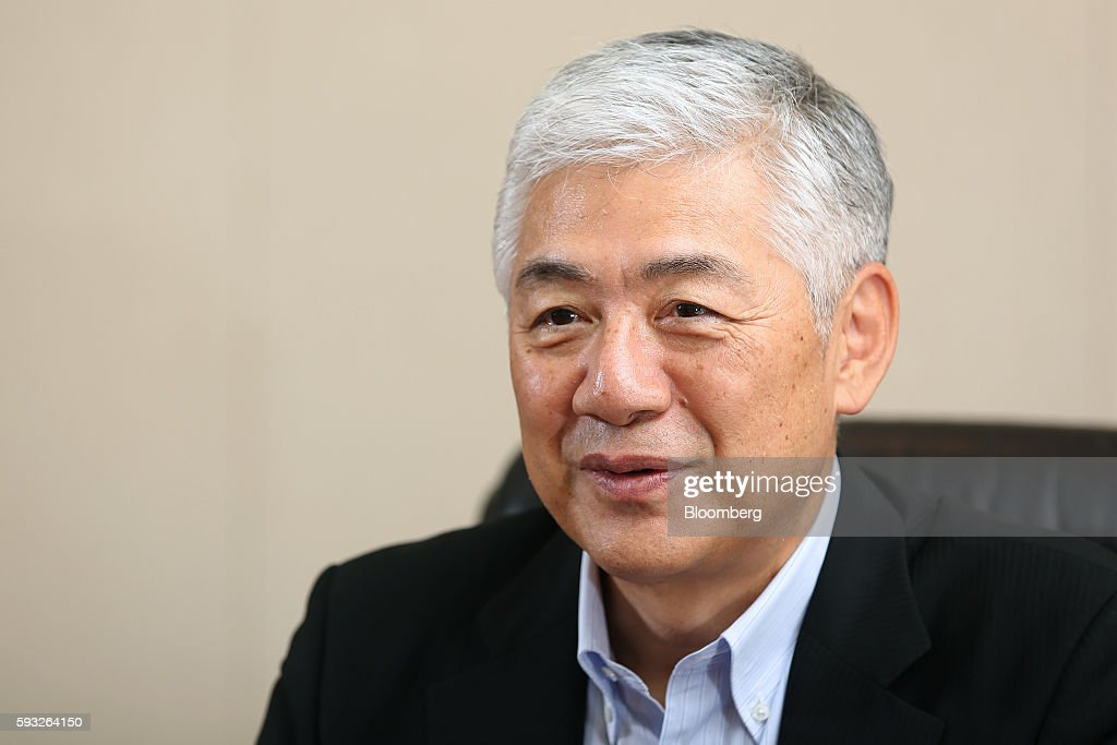 Tetsu Ozaki chief operating officer of Nomura Holdings Inc listens during an interview at the company headquarters in Tokyo Japan on Monday Aug 15...