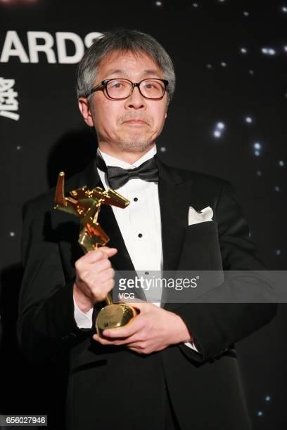 Tetsuo Ohya winner of the Best Visual Effects award for 'Shin Godzilla' celebrates at the backstage during the 11th Asian Film Awards at Hong Kong...