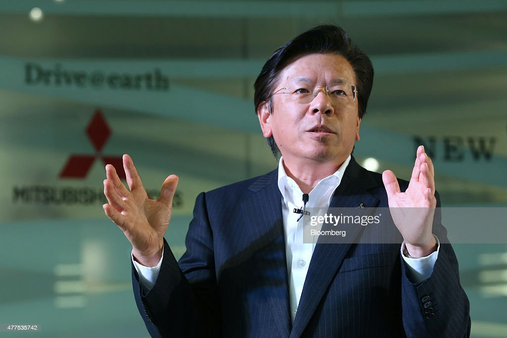 Tetsuro Aikawa president and chief operating officer of Mitsubishi Motors Corp speaks during the unveiling of the company's new Outlander PHEV...