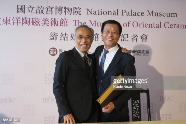 Tetsuro Degawa director of the Museum of Oriental Ceramics Osaka and Jasper Lin director of Taiwan's National Palace Museum pose for photos in Taipei...