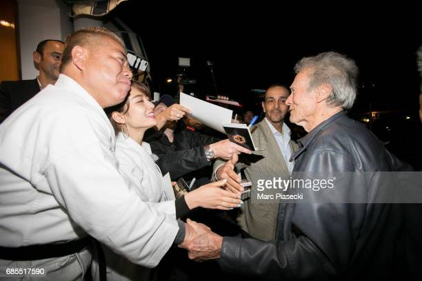 Tetsuro Degawa meets actor Clint Eastwood as he leaves the 'Tetou' restaurant during the 70th annual Cannes Film Festival on May 19 2017 in Golfe...