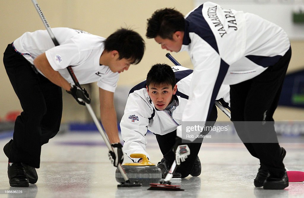 Tetsuro Shimizu of Japan delivers his stone during the Pacific Asia 2012 Curling Championship at the Naseby Indoor Curling Arena on November 23, 2012 in Naseby, New Zealand.