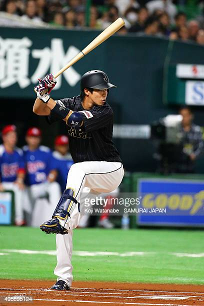 Tetsuto Yamada of Japan bats during the sendoff friendly match for WBSC Premier 12 between Japan and Puerto Rico at the Fukuoka Dome on November 5...