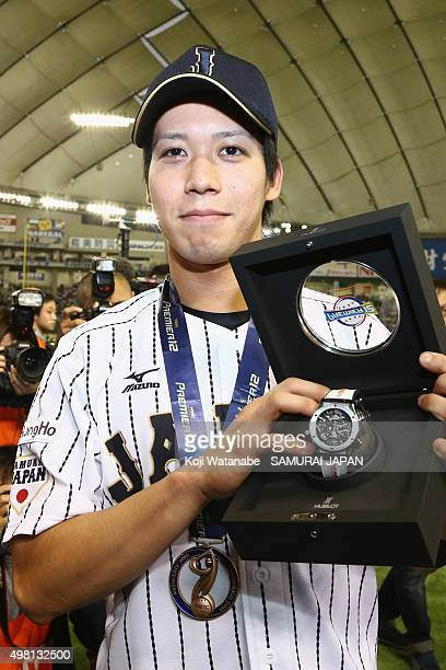 Tetsuto Yamada of Japan poses for a photo after winning the WBSC Premier 12 third place play off match between Japan and Mexico at the Tokyo Dome on...