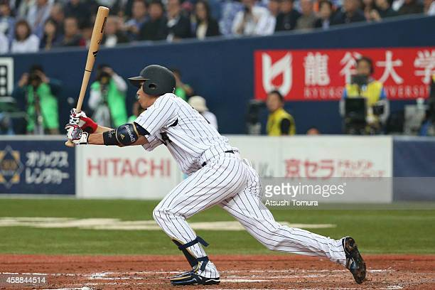 Tetsuto Yamada of Samurai Japan hits an RBI single in the fourth inning during the Game one of Samurai Japan and MLB All Stars at Kyocera Dome Osaka...