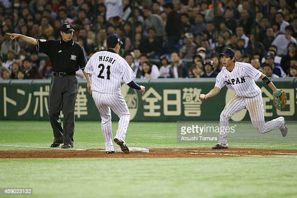 Tetsuto Yamada of Samurai Japan in action in the seventh inning during the game three of Samurai Japan and MLB All Stars at Tokyo Dome on November 15...
