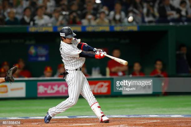 Tetsuto Yamada of Team Japan hits a sacrifice fly in the first inning during Game 6 of Pool B against Team China at the Tokyo Dome on Friday March 10...